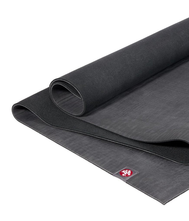 Manduka eKO 6mm Yoga Mat - Charcoal - half unrolled | Eco Yoga Store