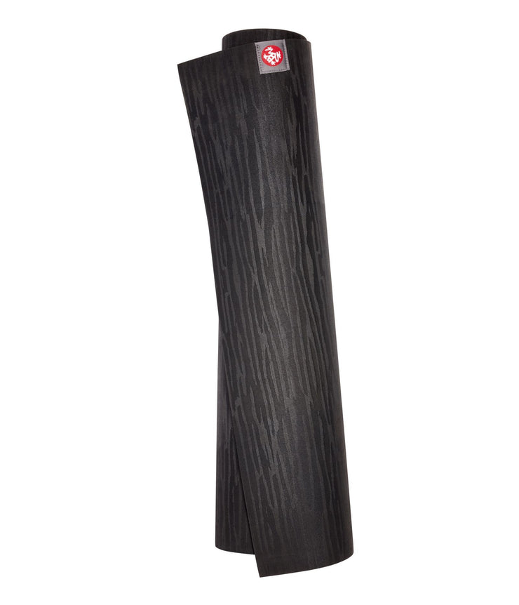 Manduka eKOLite 4mm Yoga Mat - Black - rolled vertical | Eco Yoga Store