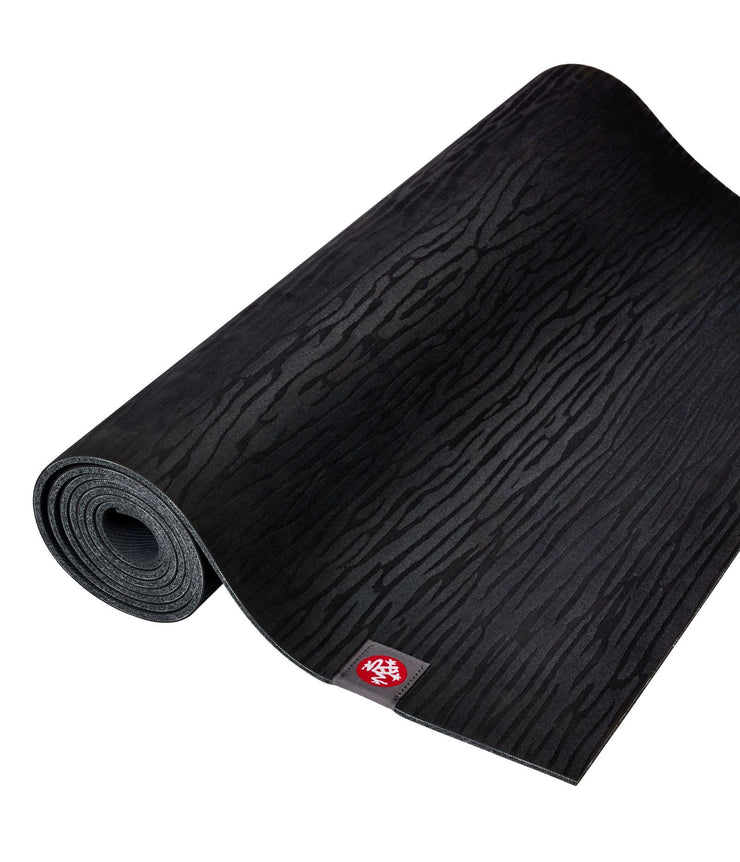 Manduka eKOLite 4mm Yoga Mat - Black - rolled flat | Eco Yoga Store