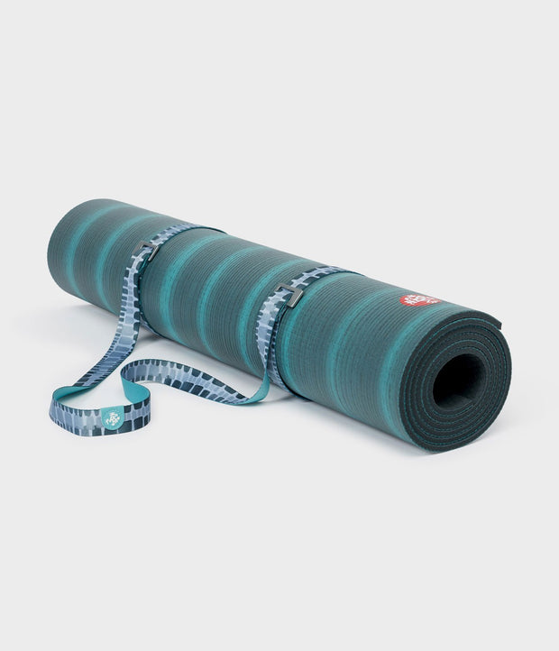 Manduka Go Move Mat Sling - Patina Squares - rolled around a yoga mat | Eco Yoga Store