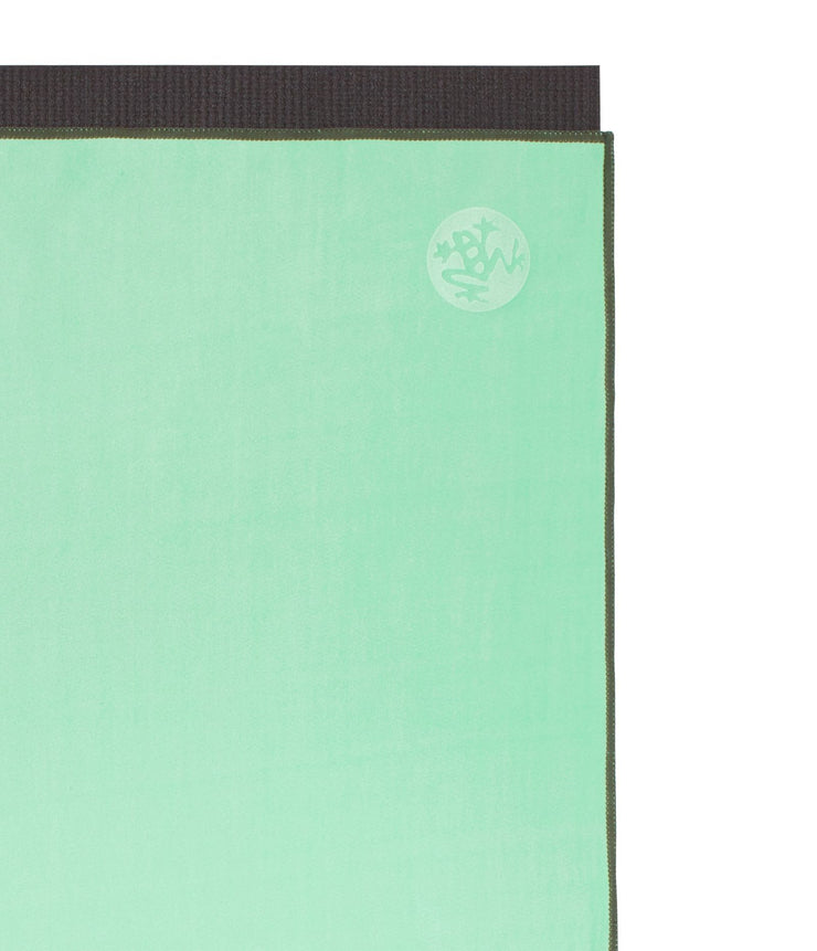 Manduka eQua Mat Towel - Green Ash - on top of a yoga mat| Eco Yoga Store