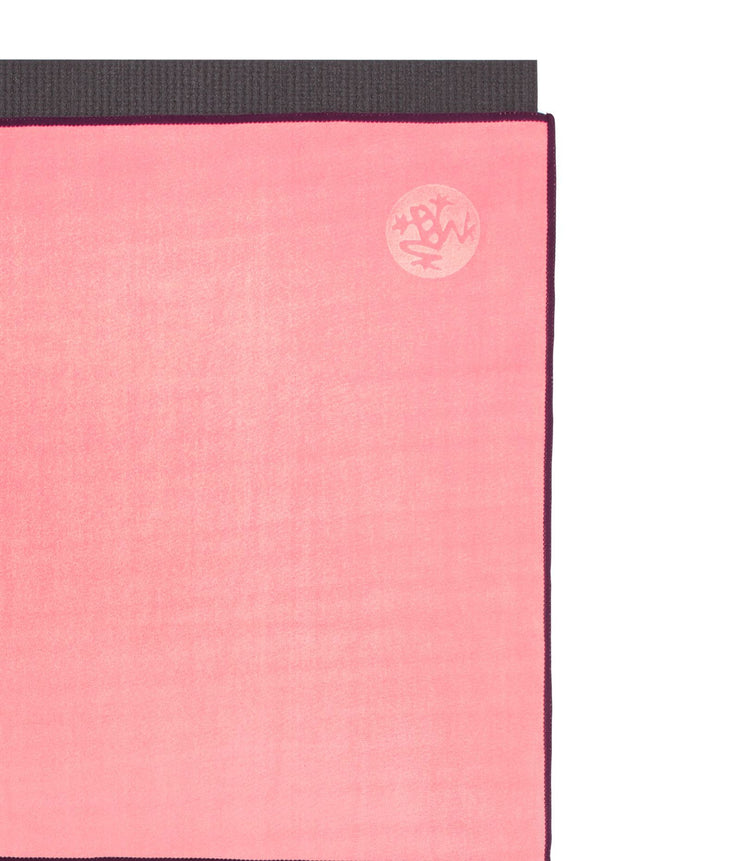 Manduka eQua Mat Towel - Desert Flower - on top of a yoga mat | Eco Yoga Store