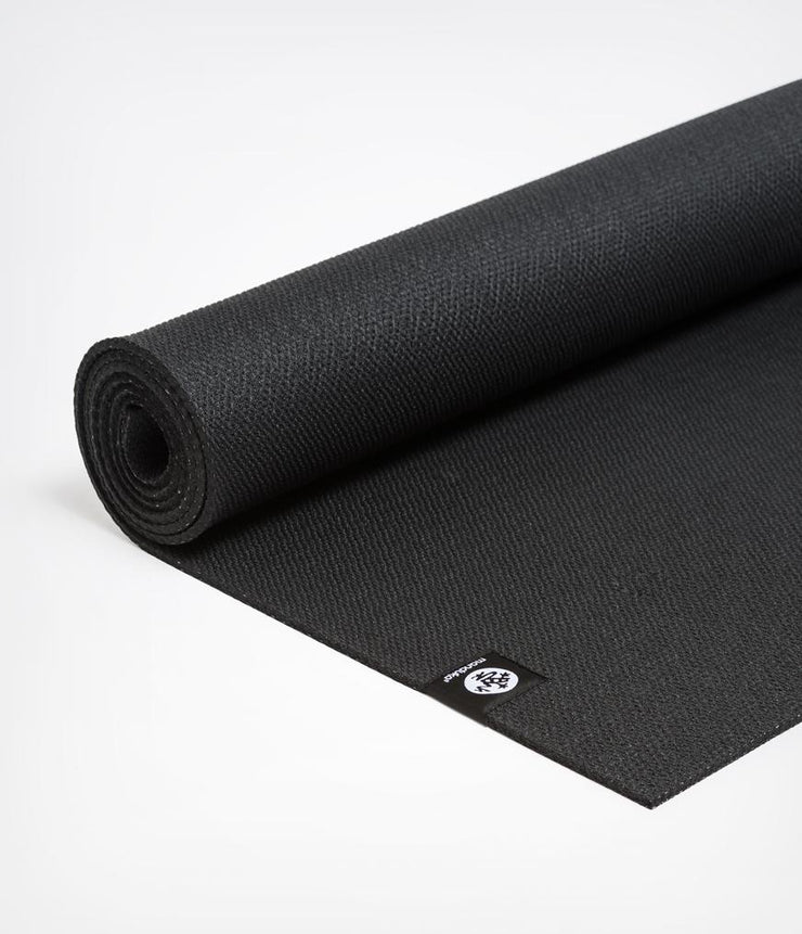 Manduka X 5mm Yoga Mat - Black - Semi unfurled | Eco Yoga Store