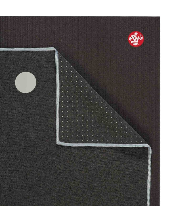Manduka Yogitoes Mat Towel - Grey - lying flat, corner folded over | Eco Yoga Store