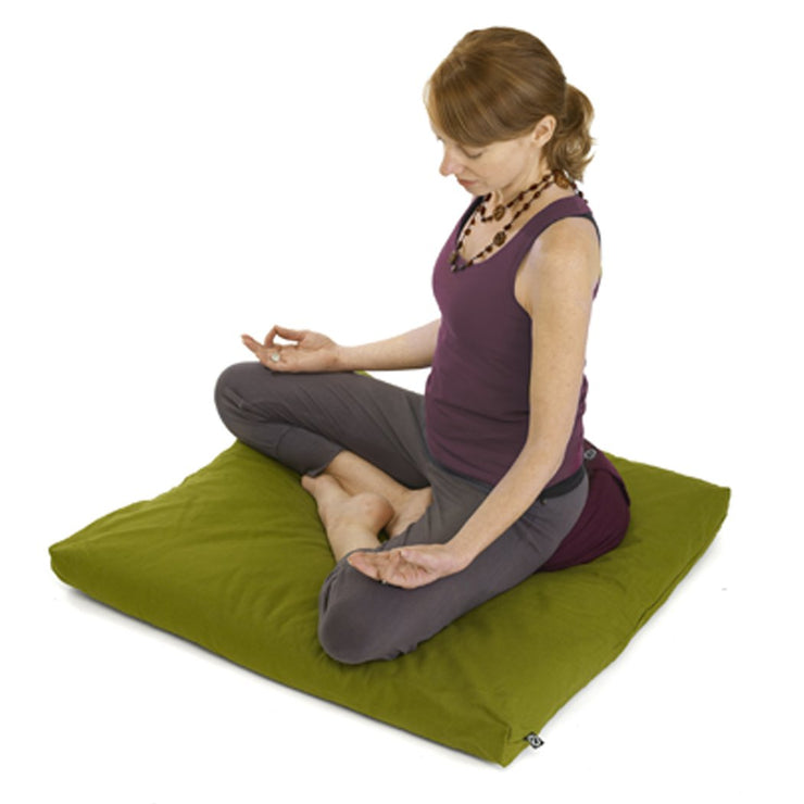 ORA Zabuton Meditation Mat - Olive - yogi sitting on mat | Eco Yoga Store