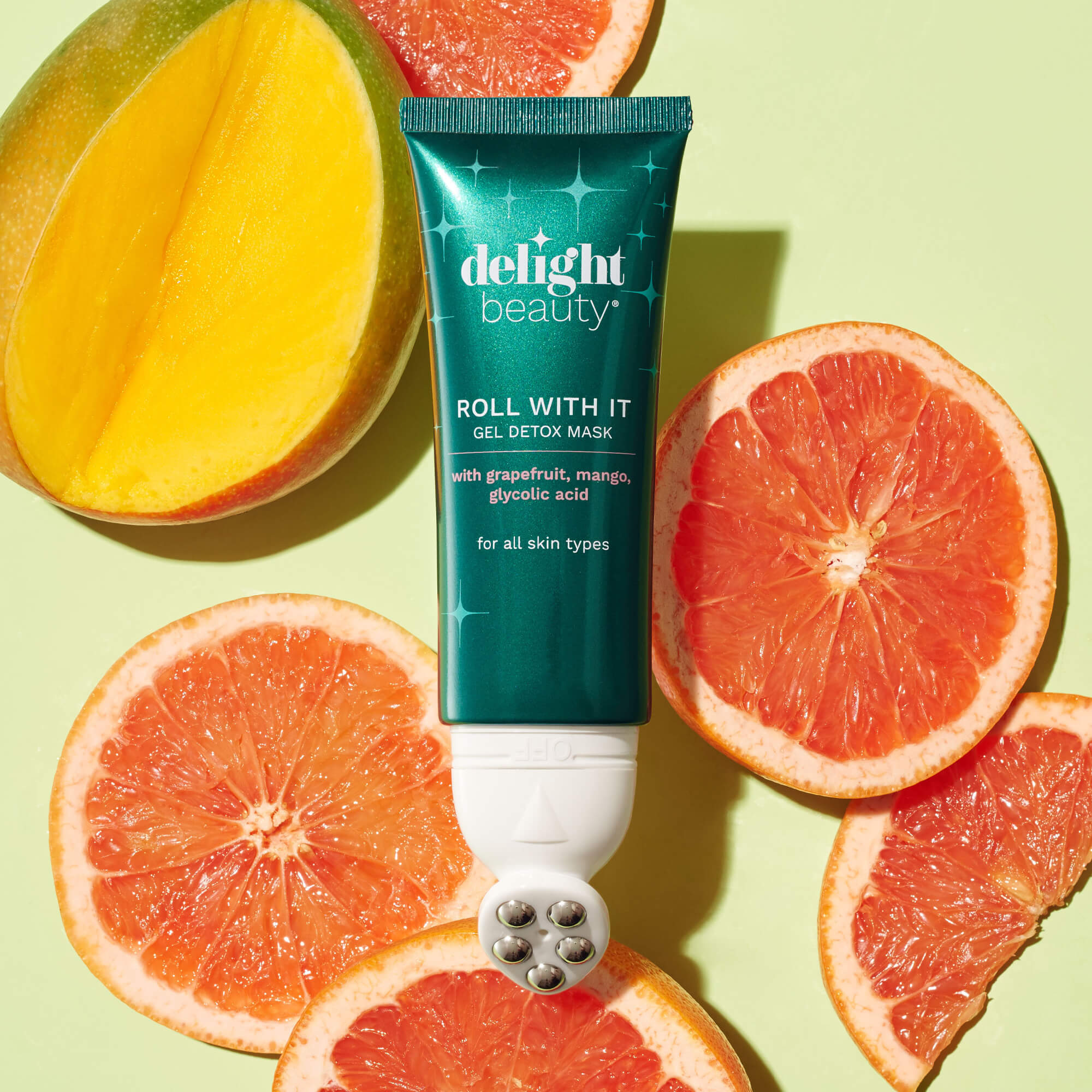 roll with it gel detox mask surrounded by slices of fresh mango and grapefruit
