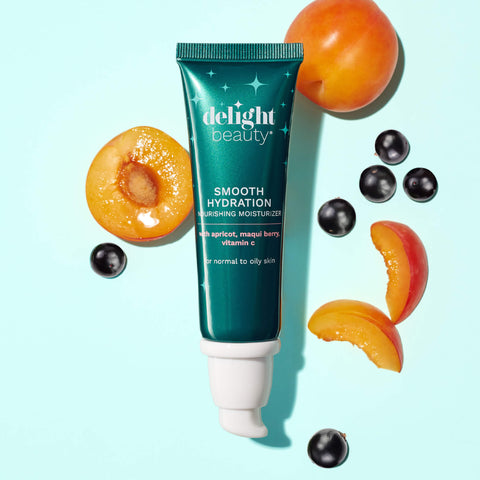 smooth hydration nourishing moisturizer surrounded by fresh maqui berries and apricot slices