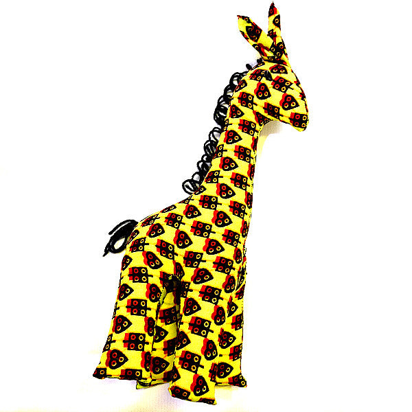 Giraffe toy with yellow and red african print pattern