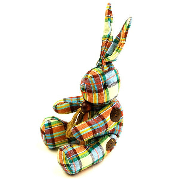 A handmade stuffed easter bunny toy with mixed colours chequered fabric.