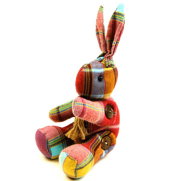 A handmade stuffed easter bunny toy with chequered fabric in pink and blue