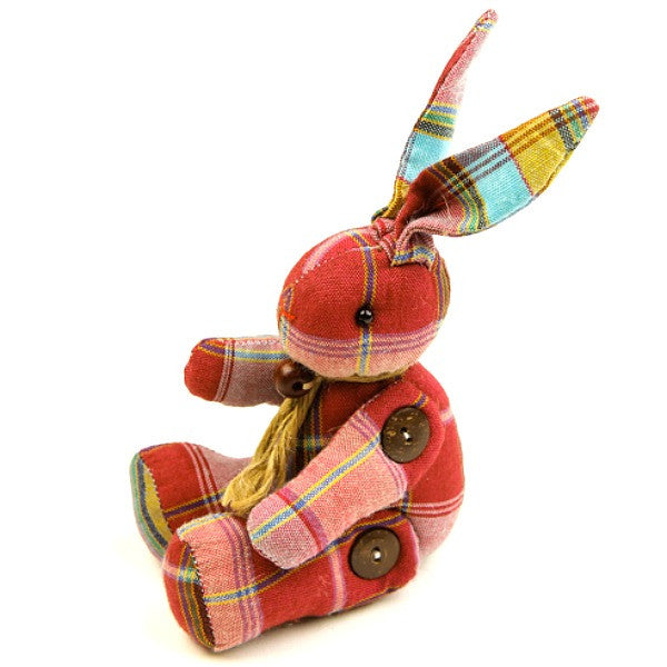 A handmade stuffed easter bunny toy with chequered fabric in red