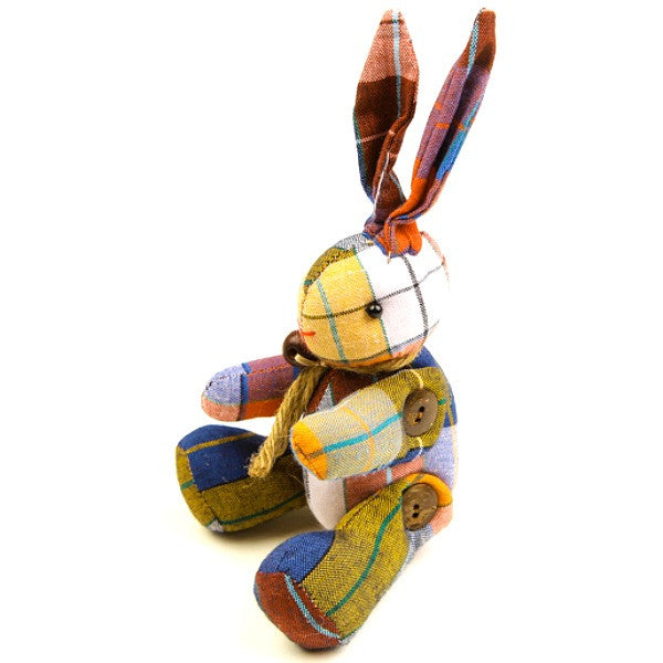 A handmade stuffed easter bunny toy with yellow and white chequered fabric.
