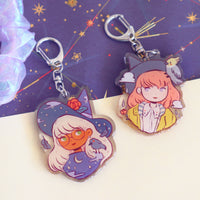 Raven and Cockatiel witches - Acrylic keychains
