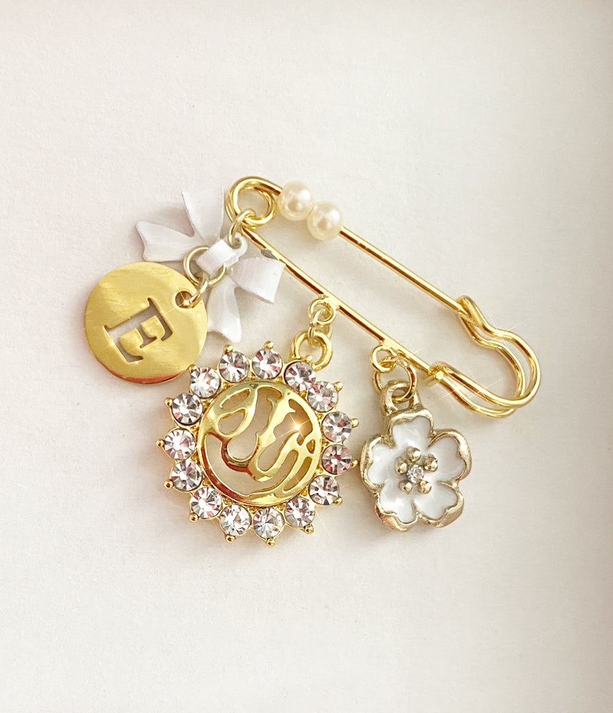 Small gold initial pin in white for girl