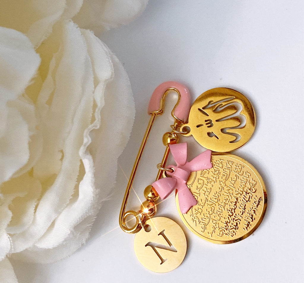 Small pink initial pin with gold ayat Kursi and Allah