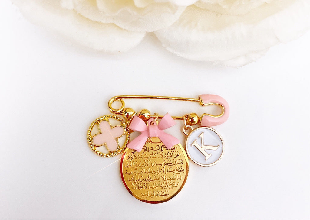 Small pink ball initial pin with ayat Kursi