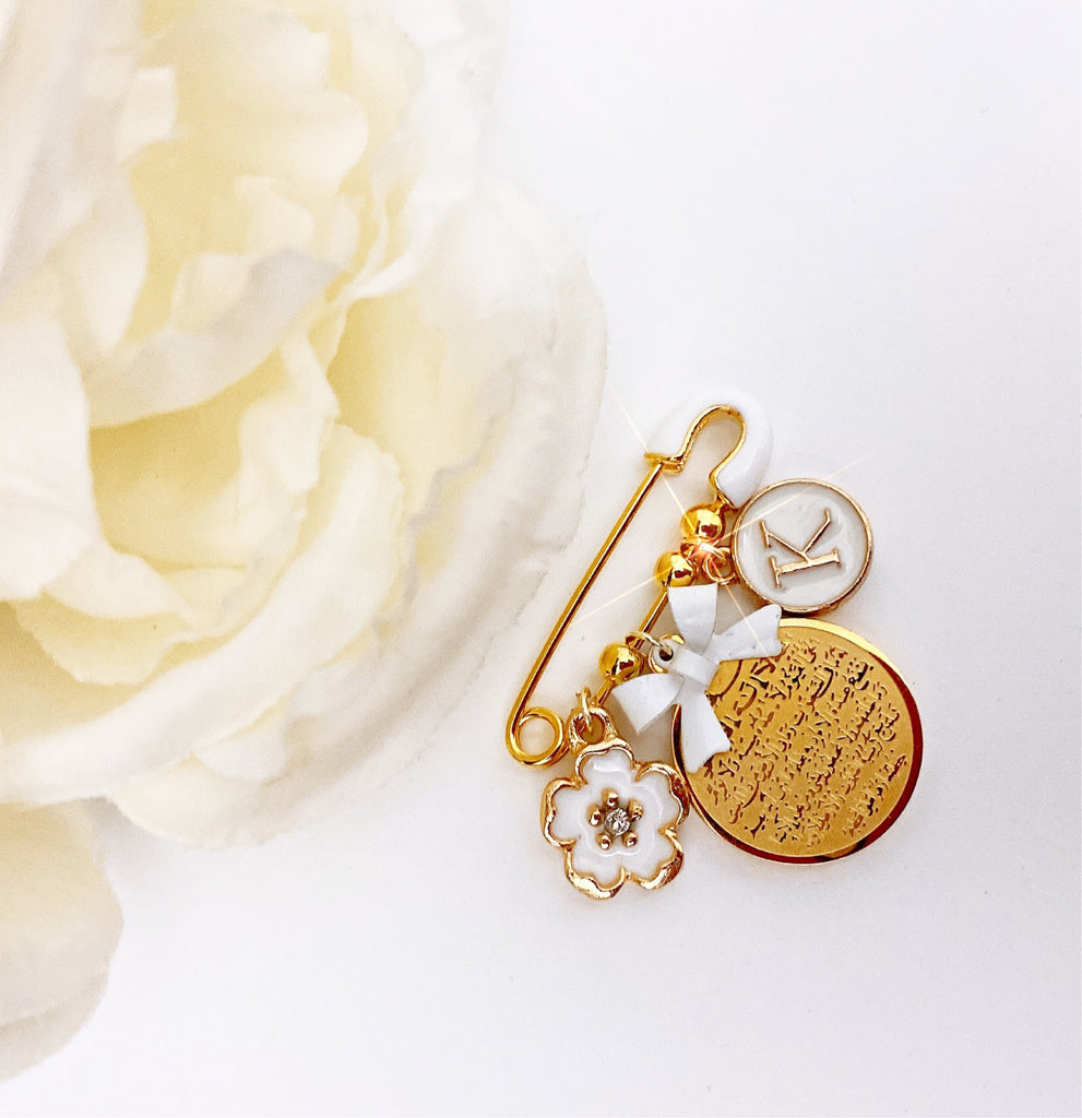 Small white initial pin with ayat Kursi, flower