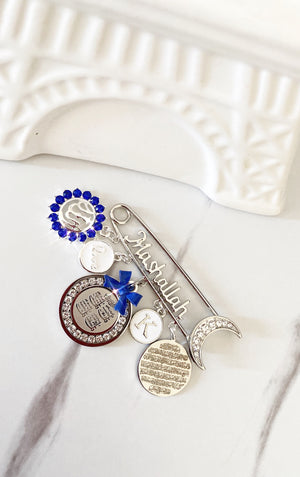 Silver Mashallah initial pin in royal blue