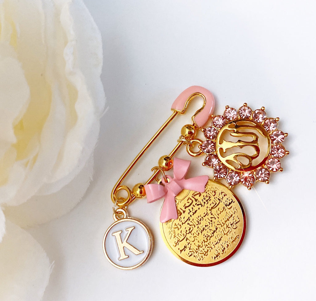 Small pink initial pin with ayat Kursi, Allah