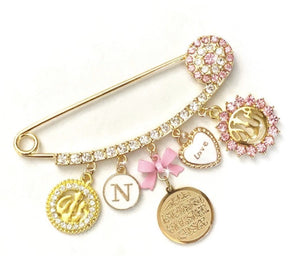 Gold pin with charms and initial for girl
