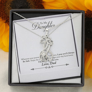 An adorable Giraffe pendant necklace.