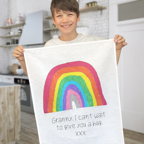tea towel printed with child's drawing.