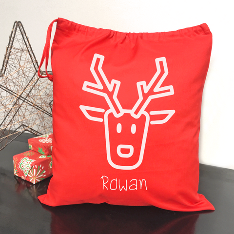 Child's personalised Christmas gift bag with reindeer.