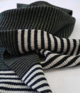 Classic mens stripe scarf in black white and green. Knitted in Scottish spun lambs wool & sustainably made in UK