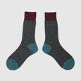 Men's and women's wool socks made in the UK in rustic marl colours. Sustainable British knitwear label.