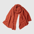 Orange lambs wool garter stitch scarf for men and women, lightweight shawl. Designed and sustainably made in the UK.