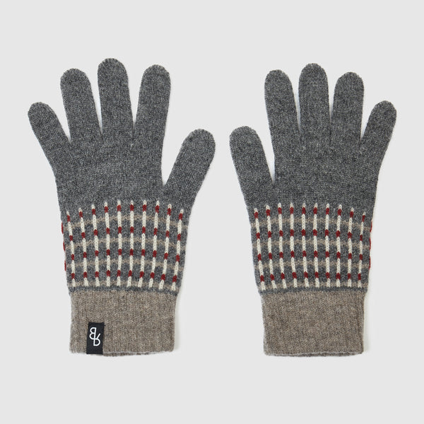 Knitted lambs wool men's and women's gloves designed and made in the UK. Sustainable British knitwear label.
