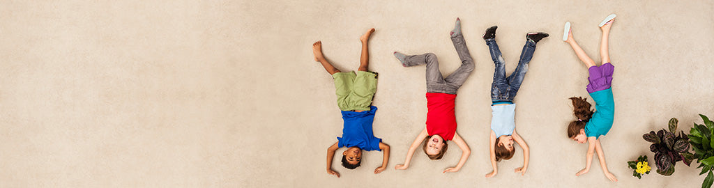 Children posing upside down