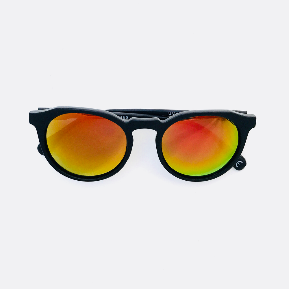 Hillwood - Matte Black frame with Sunset Orange Pentoptic®️ Lens.