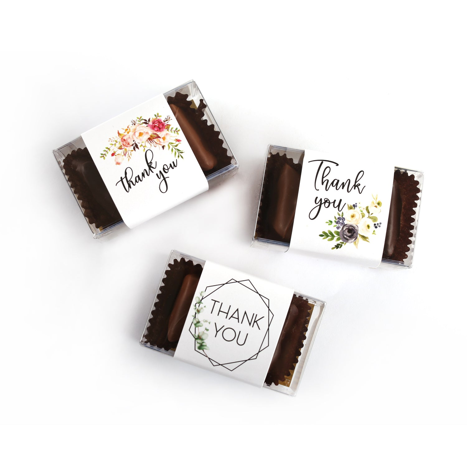 Photo of different band options. A pink floral thank you in black script font. Another thank you band with black script font and white and purple flowers. Last a geometric decorative box with thank you in uppercase letters