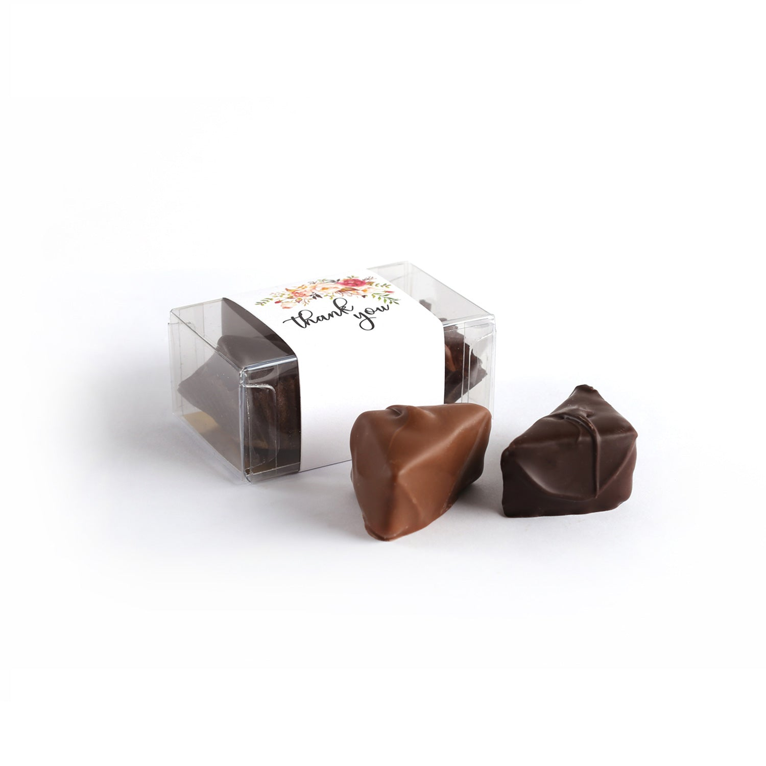 Product photo of two chocolate clear box truffle