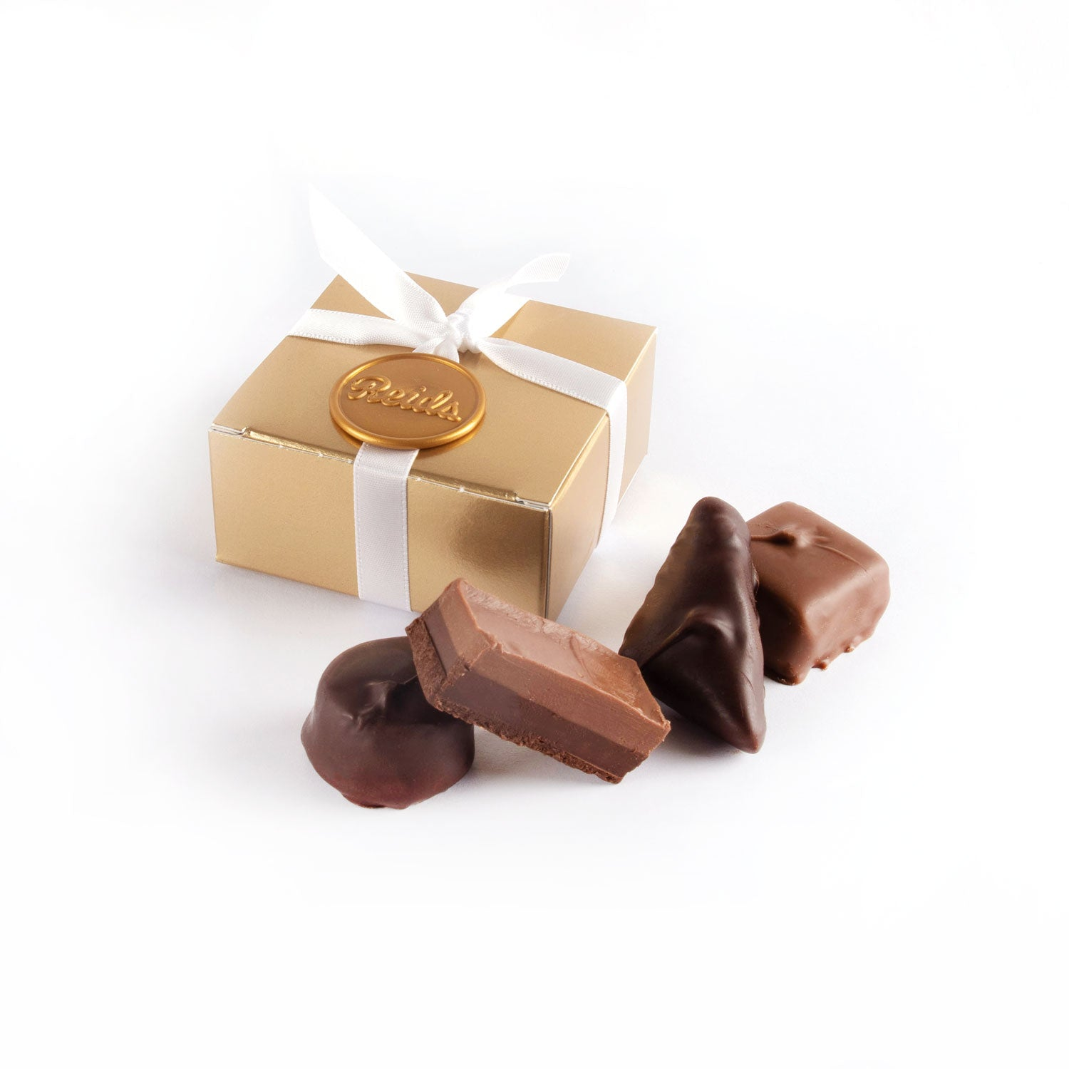 Product photo of square box that fits 4 chocolates with ribbon and wax seal
