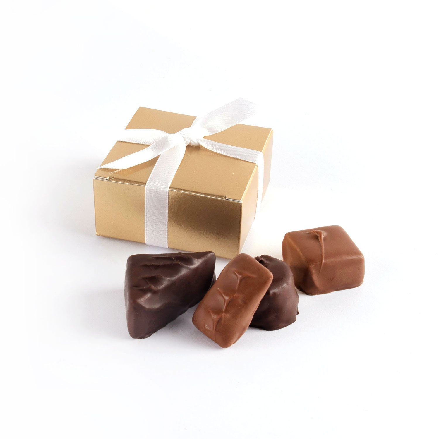 Product photo of square box that fits 4 chocolates with satin bow
