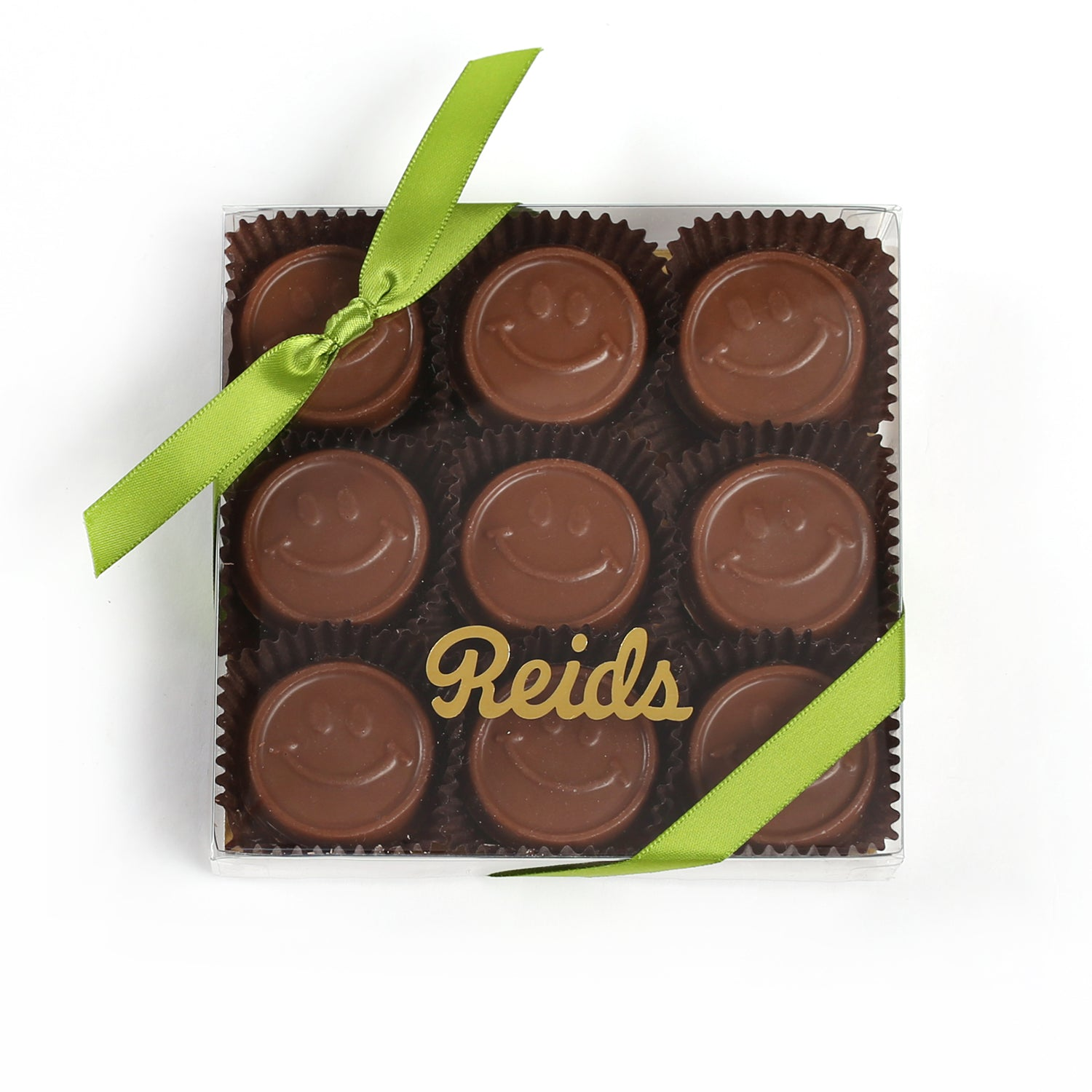 Product photo of smile chocolate bites box with green ribbon