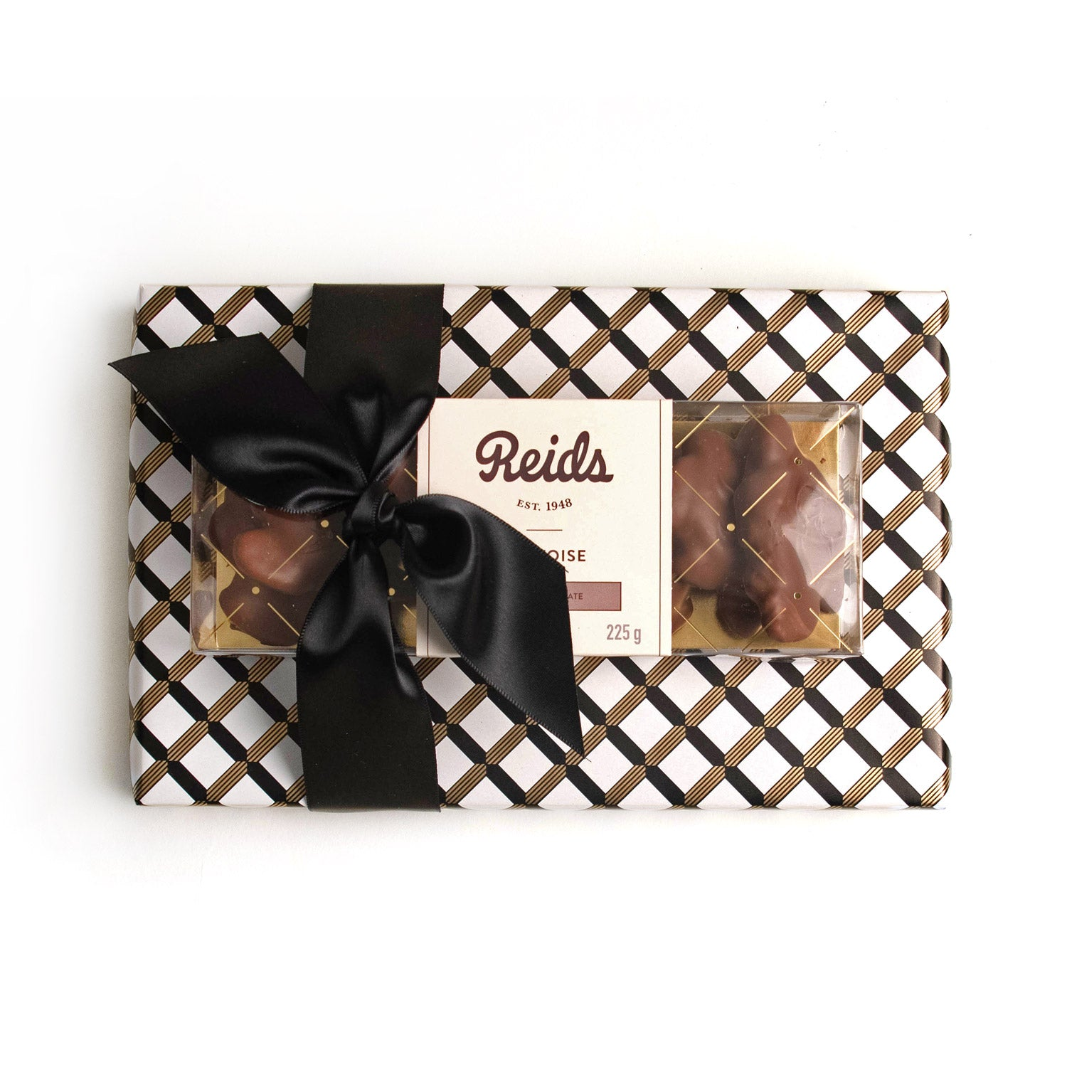 Product photo of double treat. Black, gold and white wrapping paper. Tied with a satin black ribbon