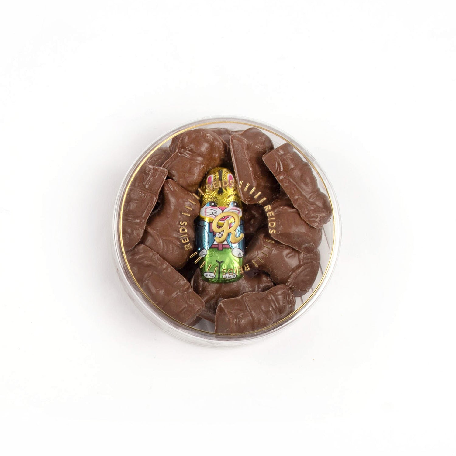 Clear round box filled with chocolate and one foiled bunny