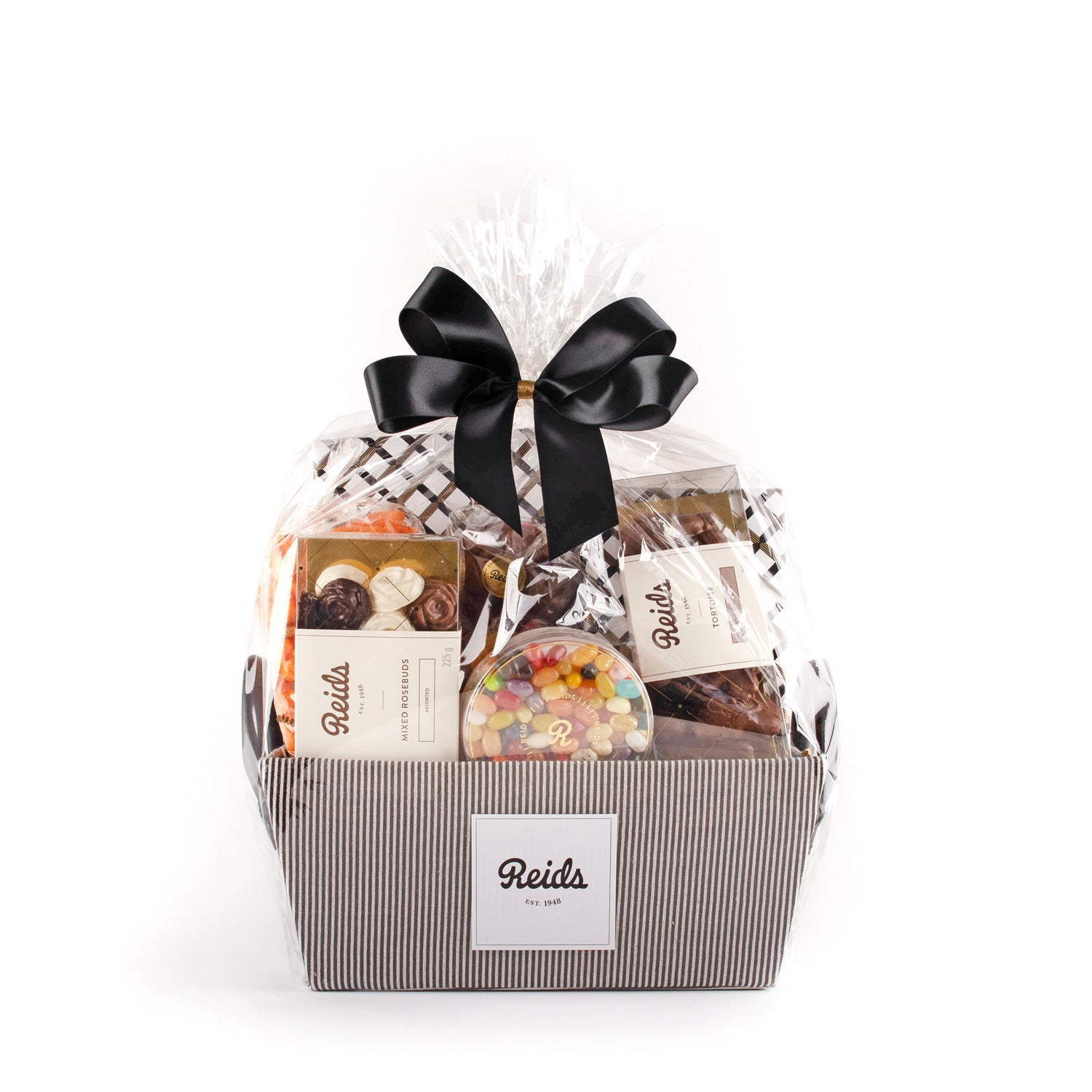 The medium basket comes in a black and white pinstriped basket wrapped in cellophane and tied with a black stain bow