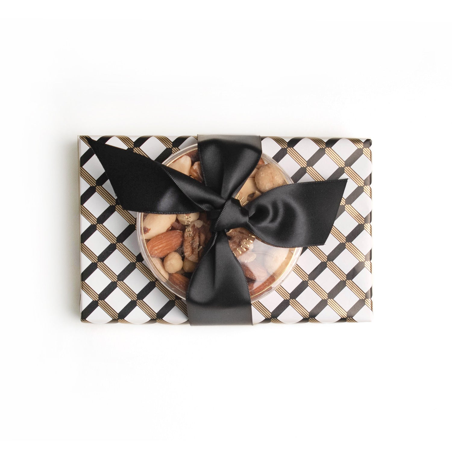 Black, gold and white wrapping paper. Tied with a satin black ribbon