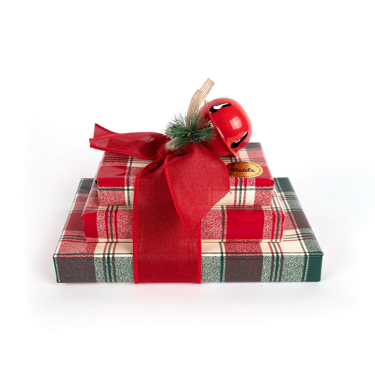 A tour of our bestsellers featuring 1/2 lb fancy mixed nuts, 1/2 lb tortoises, and 1 lb assorted chocolates, wrapped for the holidays in a plaid wrapping paper..