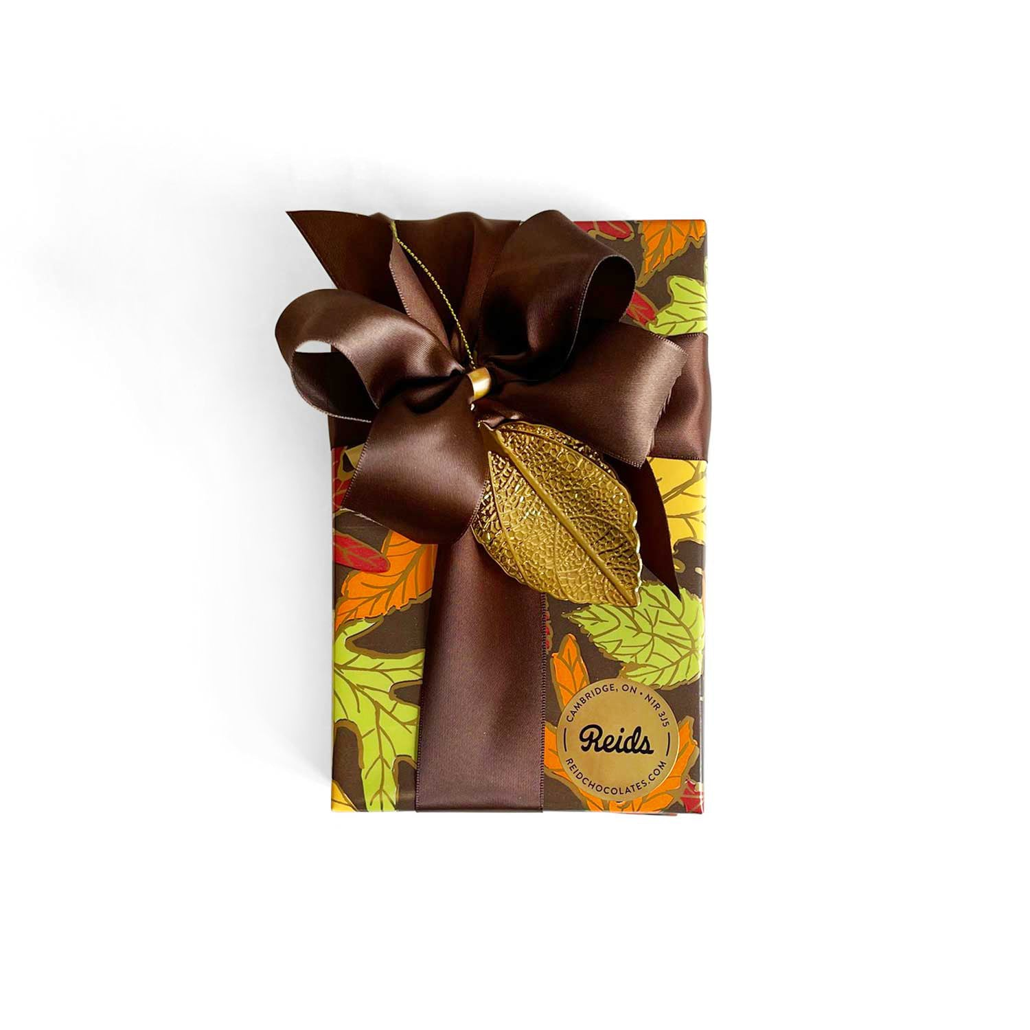 1/2 lb box of assorted chocolates wrapped for the fall season