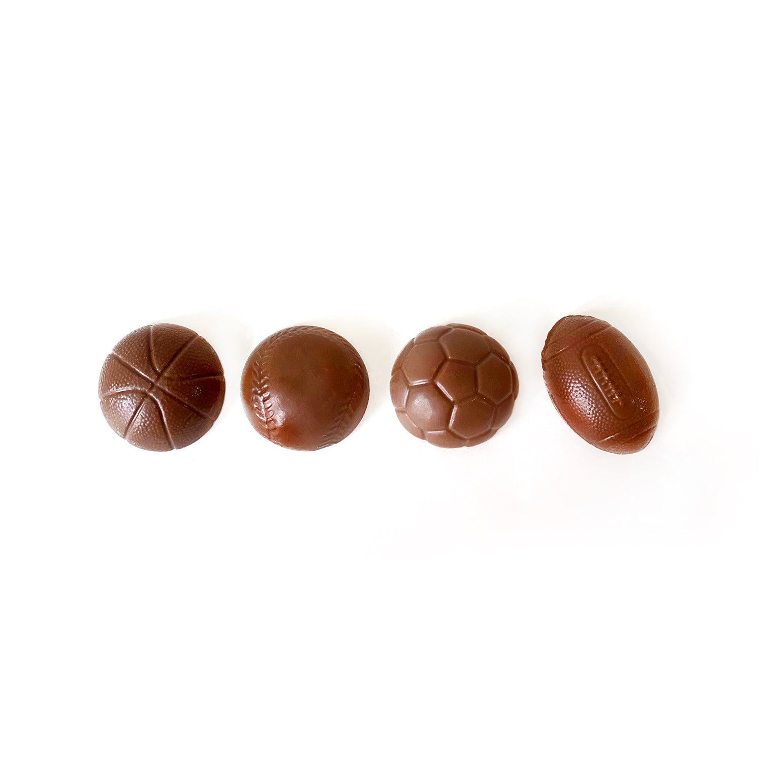 Milk chocolate sports balls for your sporty dad.