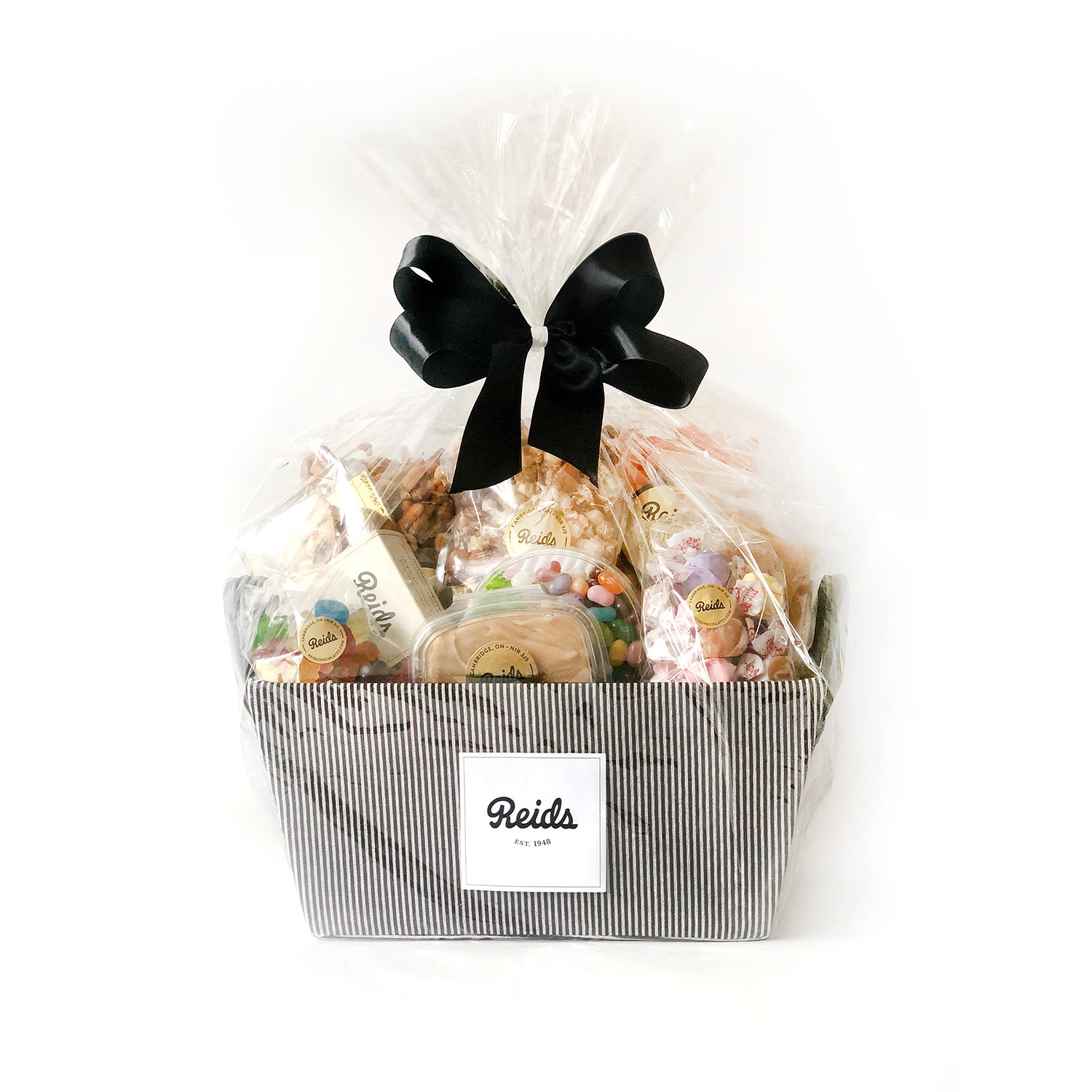 This basket is filled with treats perfect for the hot weather; Nut crisp, peanut brittle, nuts and bolts, Cajun crunch, Fancy mix nuts, Maple fudge, Salt Water taffy, 1/2 lb candy mix and jelly bellies.