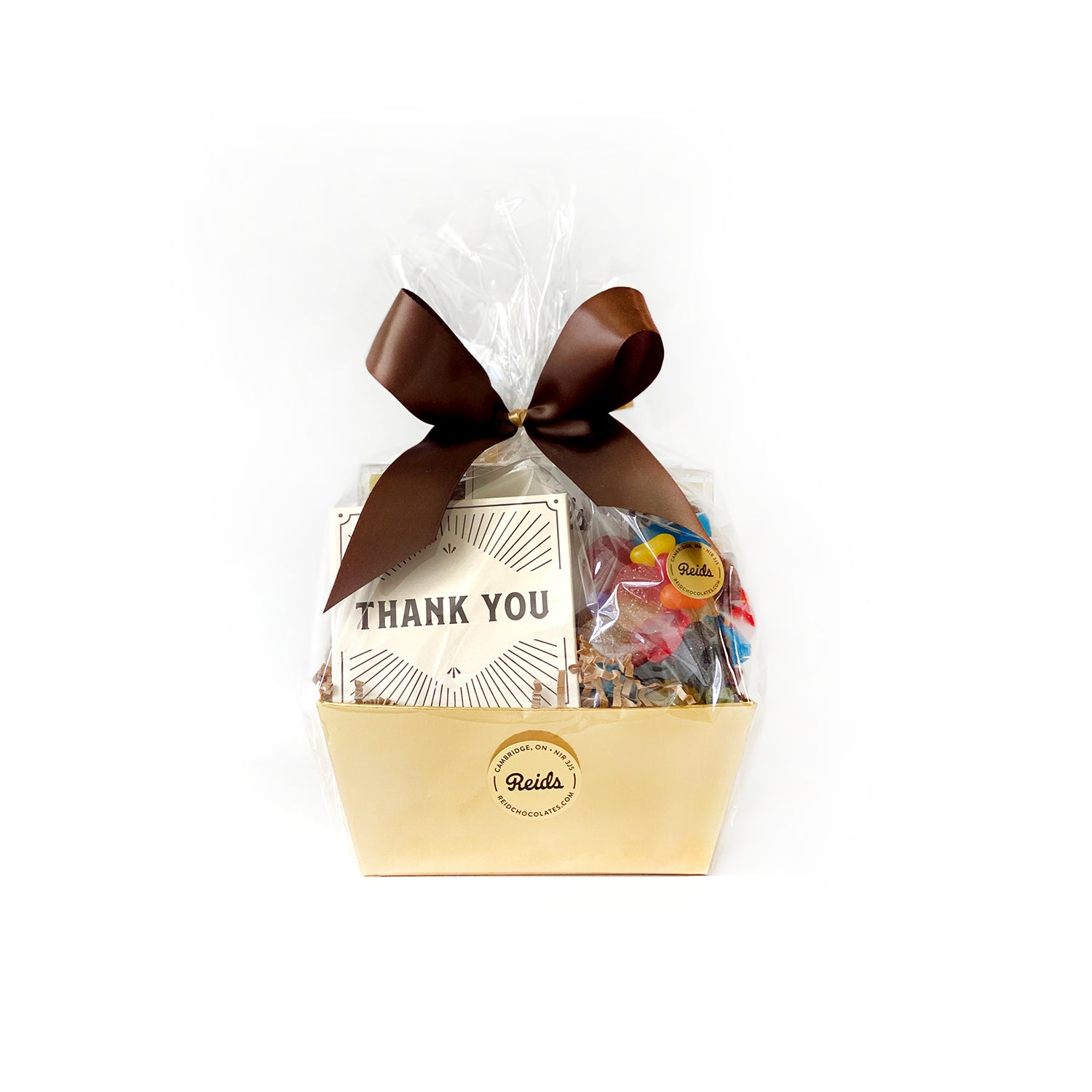 A basket filled with 100 g assorted chocolates, 1/2 lb rosebuds, and 1/2 lb bag of candy. Perfect to say Thank You.