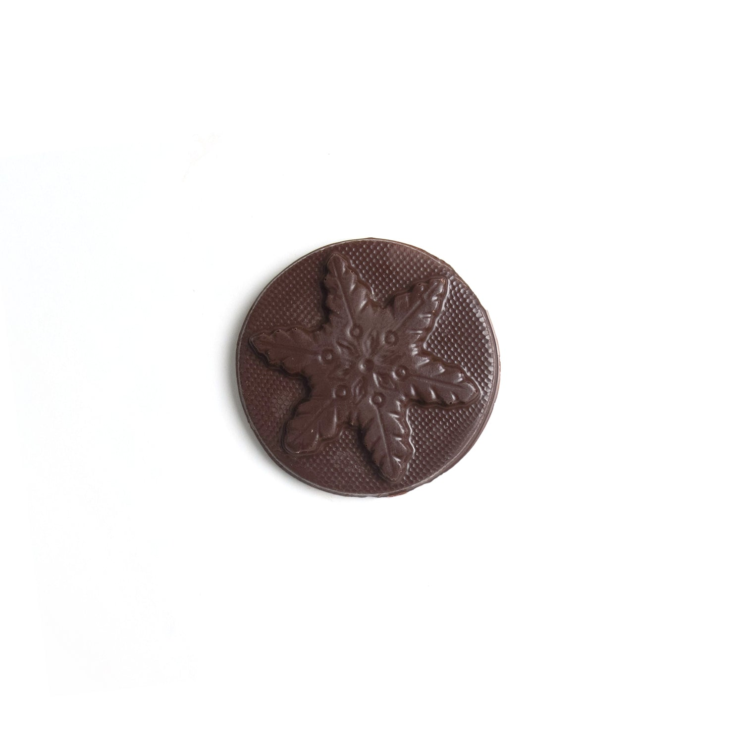 Product photo of dark chocolate snowflake mold. A round disk of chocolate with a snowflake.