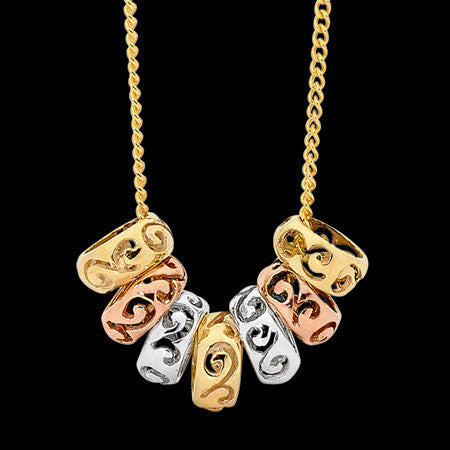 THREE TONE 9 KARAT GOLD SEVEN LUCKY RINGS NECKLACE