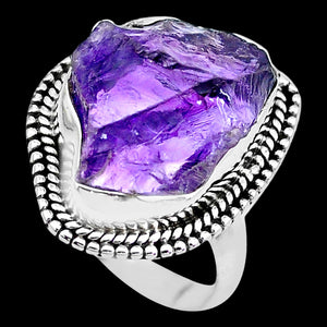 STERLING SILVER 10 CARAT ROUGH AMETHYST SURROUND RING